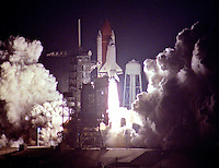 Space Shuttle Discovery blasts off into the night of November 22, 1989 to begin the STS33 mission carrying her crew of five: Commander Frederick D. Gregory, Pilot John E. Blaha, Mission Specialists F. Story Musgrave, Manley L. Carter, Jr. and Kathryn C. Thornton, Kennedy Space Center, Titusville, FL.  (Photo by Brian Cleary/www.bcpix.com)