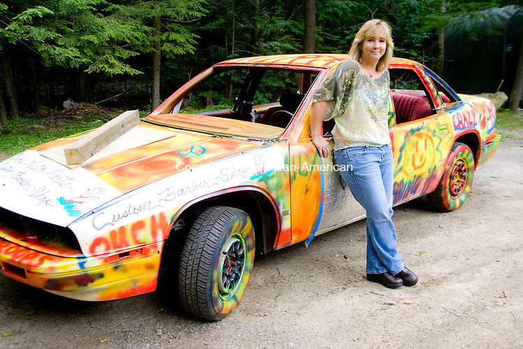 WINSTED, CT - 16 JUNE 2010 -061610JT04-<br /> Tracy Hilpert of Winchester stands next to the 1992 Buick Regal that she will compete with in this weekend's demolition derby at the Goshen Stampede.<br /> Josalee Thrift Republican-American