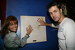 "Mandy & John check out the handprints of Meg Ryan - Guiding Light's Mandy Bruno ""Marina Cooper"" celebrated her birthday at Planet Hollywood, NYC by throwing for her friends and castmates a party on Sept. 23, 2006. Her birthday was on the 20th of Sept. Here she poses with John Driscoll ""Coop"". (Photo by Sue Coflin/Max Photos)"