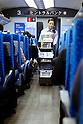 Osaka, JP - January 21, 2015 : A female snack vender serves passengers on the Shinkansen bullet train traveling to Osaka from Tokyo. (Photo by Rodrigo Reyes Marin/AFLO)