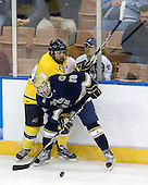 Stephane Da Costa (Merrimack - 24), T.J. Tynan (Notre Dame - 18) - The University of Notre Dame Fighting Irish defeated the Merrimack College Warriors 4-3 in overtime in their NCAA Northeast Regional Semi-Final on Saturday, March 26, 2011, at Verizon Wireless Arena in Manchester, New Hampshire.