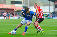 Macclesfield Town's James Pearson shields the ball from Lincoln City's Danny Rowe<br /> <br /> Photographer Chris Vaughan/CameraSport<br /> <br /> The EFL Sky Bet League Two - Lincoln City v Macclesfield Town - Saturday 30th March 2019 - Sincil Bank - Lincoln<br /> <br /> World Copyright © 2019 CameraSport. All rights reserved. 43 Linden Ave. Countesthorpe. Leicester. England. LE8 5PG - Tel: +44 (0) 116 277 4147 - admin@camerasport.com - www.camerasport.com