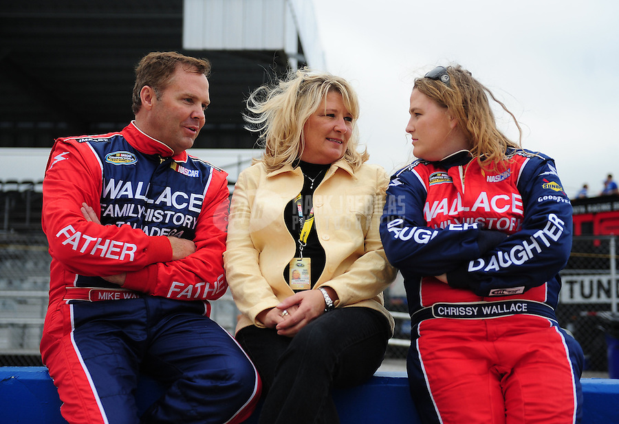 Oct. 30, 2009; Talladega, AL, USA; NASCAR Camping World Truck Series driver Mike Wallace (left) and wife Carla Wallace (center) talk with daughter Chrissy Wallace during qualifying for the Mountain Dew 250 at the Talladega Superspeedway. Mandatory Credit: Mark J. Rebilas-