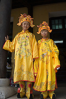 Children dress up in traditional court costumes, including wonderful shoes and hats, in order to have their photographs taken at the Citadel in Hue, which was once the capital of Vietnam.