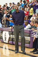 Coach Black using his charm with a referee in a game against San Marcos November 21, 2014 at Cedar Ridge.  (LOURDES M SHOAF for Round Rock Leader.)