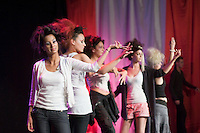 Dancers rehearse before performing during the annual X-Foto competition in the Hair & Beauty Department at Kingston College, London.