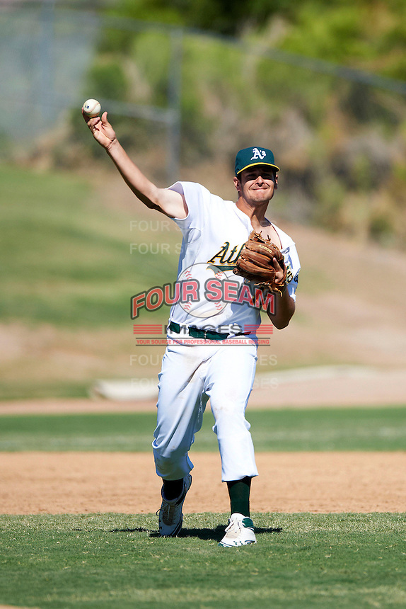 Oakland Athletics minor league infielder BA Vollmuth #15 during an instructional league game against the San Francisco Giants at the Papago Park Baseball Complex on October 17, 2012 in Phoenix, Arizona. (Mike Janes/Four Seam Images)