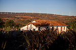 CAETITE, BRAZIL - OCTOBER 25, 2013:<br /> The home of the Silva family shows wind-turbines all around the area. The family agreed to be paid $250 a month to permit Renova Energia with wind turbines on their 46-acre land. A string of wind-turbine parks, in the municipal of Caetite, are being erected in the windiest stretches of Bahia state, Brazil, on Friday, Oct 25, 2013. <br /> (Photo by Lianne Milton/For The Washington Post