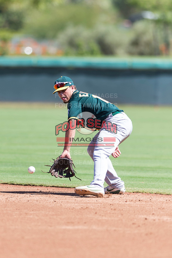 Oakland Athletics second baseman Jeremy Eierman (10) fields a ground ball during an Instructional League game against the Los Angeles Dodgers at Camelback Ranch on September 27, 2018 in Glendale, Arizona. (Zachary Lucy/Four Seam Images)