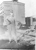 Car repairman posing in freight yard.<br /> D&amp;RG