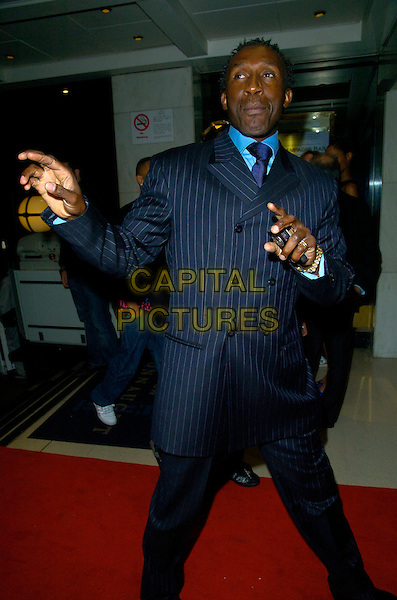 LINFORD CHRISTIE.Arrivals - The Kickers Urban Music Awards 2007,.New Connaught Rooms, Great Queen Street,.London, England, Nove,ber 3rd 2007..half length blue pinstripe suit hands funny.CAP/CAN.©Can Nguyen/Capital Pictures