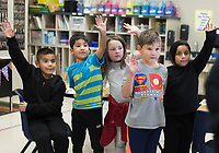 NWA Democrat-Gazette/CHARLIE KAIJO Second grade students raise their hand to participate in a recycling activity during an art class, Monday, December 3, 2018 at Russell D. Jones in Rogers.<br />