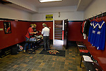 Crusaders 1 Fulham 3, 16/07/2011. Seaview Park, Europa League 2nd qualifying round first leg. Staff in the club shop (a converted former dressing room) at Seaview Park, Belfast prepare souvenirs for sale before Northern Irish club Crusaders take on Fulham in a UEFA Europa League 2nd qualifying round, first leg match. The visitors from England won by 3 goals to 1 before a crowd of 3011. Photo by Colin McPherson.
