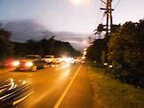 USA, Hawaii, Oahu, The North Shore, blurred view of vehicles on Kamehameha highway at dusk