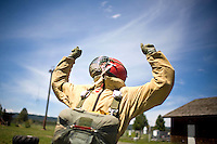 It may look like a victory celebration, but rookie smokejumper Michael Kolb is actually being tested on the proper stance for exiting a plane during a training session at McCall Smokejumper Base in McCall, ID.