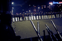 Moscow, Russia, 02/10/1993..Riot police face anti-Yeltsin barricades on the city's central ring road after preventing demonstrators from marching to the Russian Parliament, which rebel Communist and nationalist deputies, led by Vice-President Alexander Rutskoi, had occupied after President Boris Yeltsin dissolved the parliament.