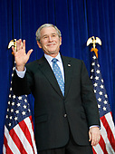 United States President George W. Bush waves after making remarks on Aviation Congestion and Transportation Safety at the U.S. Department of Transportation on November 18, 2008 in Washington DC.<br /> Credit: Aude Guerrucci / Pool via CNP
