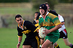 R. Johnson is all determination as he makes a run upfield. Counties Manukau Premier Club Rugby, Drury vs Bombay played at the Drury Domain, on the 14th of April 2006. Bombay won 34 - 13.