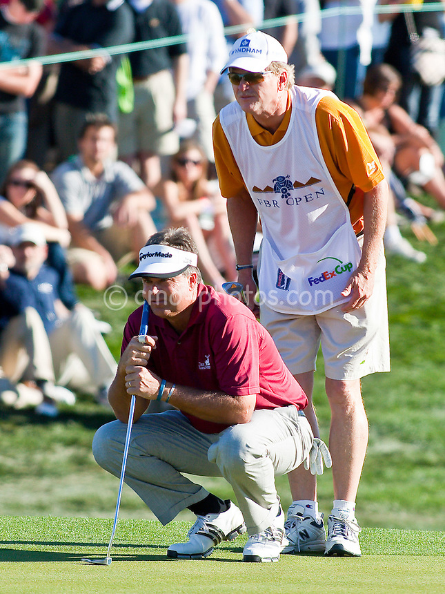 Jan 31, 2009; Scottsdale, AZ, USA; Kenny Perry (USA) and his caddie examine a putt on the 18th hole during the third round of the FBR Open at the TPC Scottsdale.  Mandatory Credit: Chris Morrison-US PRESSWIRE