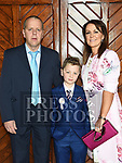 James Delaney who recieved first holy communion in the church of Mary Immaculate collon pictured with parents Thomas and Mary. Photo:Colin Bell/pressphotos.ie