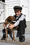 A old time period boy holding his pal a loyal dog