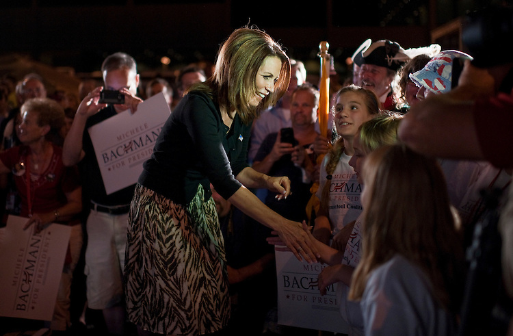 UNITED STATES - AUGUST 12:  Rep. Michele Bachmann, R-Minn., greets supporters during a rally on the campus of Iowa State University in Ames, Iowa, the night before the Ames straw poll.  (Photo By Tom Williams/Roll Call)