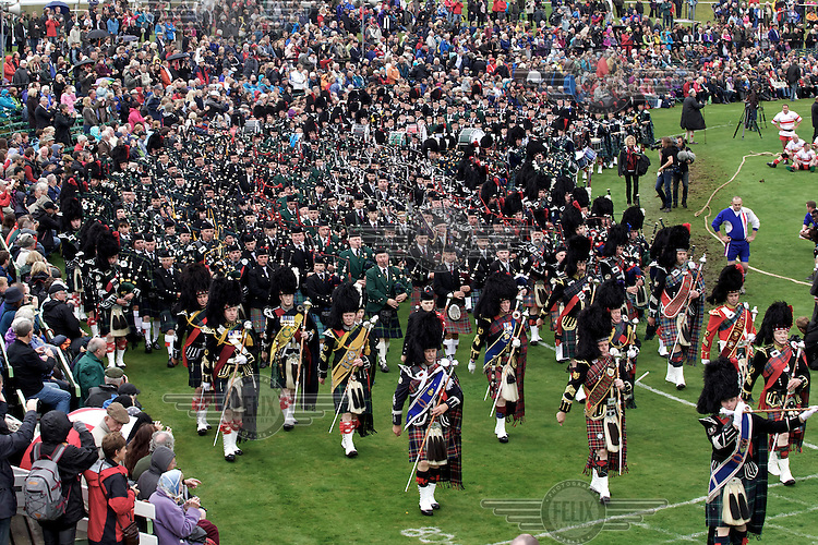 A massing of the pipes begins the Braemar Gathering, a games event held in Aberdeenshire. The event is well attended, with many tourists here to see local holidaymaker Queen Elizabeth II.