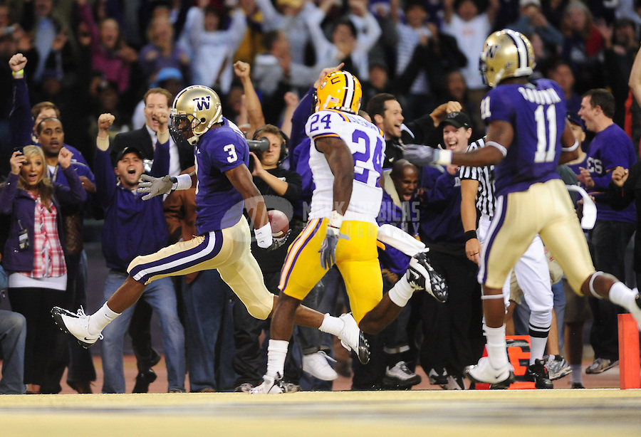 Sept. 5, 2009; Seattle, WA, USA; Washington Huskies wide receiver (3) James Johnson scores a first quarter touchdown against the LSU Tigers at Husky Stadium. Mandatory Credit: Mark J. Rebilas-