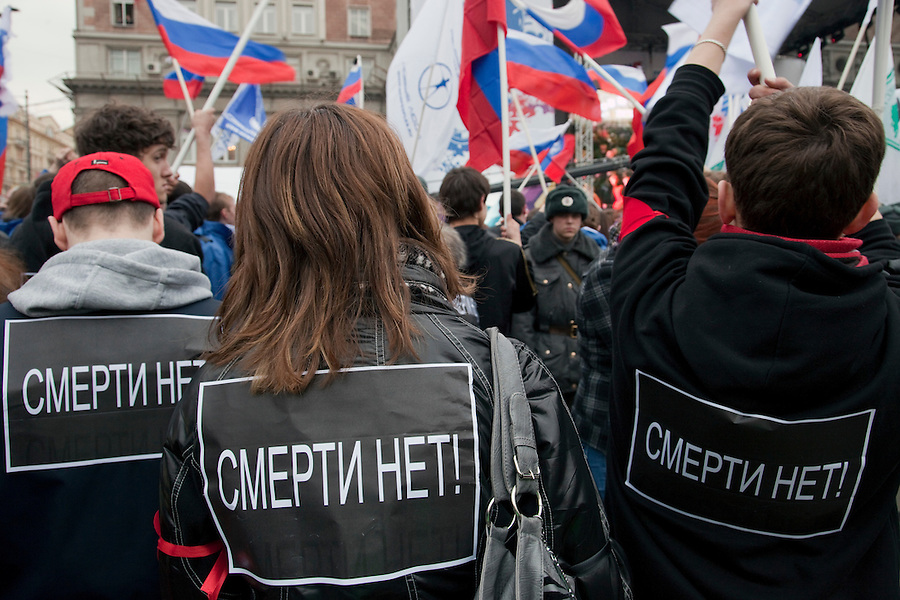 """Moscow, Russia, 31/03/2010..People wearing posters reading """"no the death"""" at a government sponsored rally against terrorism, organised by a range of pro-Kremlin youth movements, two days after the suicide bombings that killed 39 and injured 82 on the Moscow metro system."""