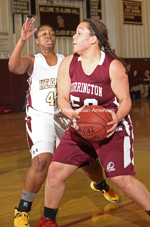 WATERBURY, CT-25 January 012514MK15 Torrington's Kendra Covington (50) looks to drive to the hoop as Sacred Heart's Maya Eggleston (42) defends during NVL girl's basketball action Saturday evening at Sacred Heart High School.  Sacred Heart defeated Torrington 50-42. Michael Kabelka / Republican-American