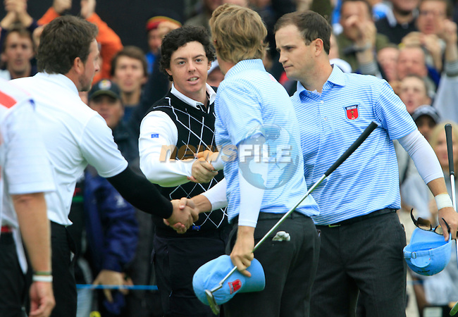 Graeme McDowell and Rory McIlroy beat Zach Johnson and Hunter Mahan 3and1 on the 17th green in the Session 3 Foursomes and Fourball Matches during Day 3 of the The 2010 Ryder Cup at the Celtic Manor, Newport, Wales, 3rd October 2010..(Picture Eoin Clarke/www.golffile.ie)