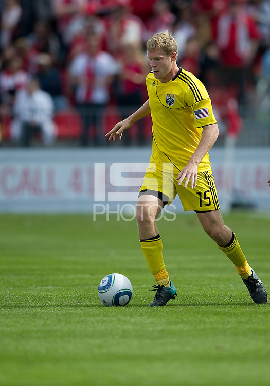 23 April 2011: Columbus Crew midfielder Kevin Burns #15 in action during a game between the Columbus Crew and the Toronto FC at BMO Field in Toronto, Ontario Canada..The game ended in a 1-1 draw.