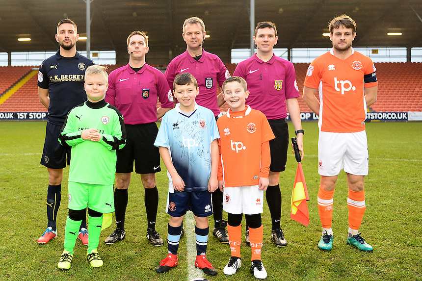 The matchday mascots line up with Referee Chris Sarginson and the Team Captains<br /> <br /> Photographer Richard Martin-Roberts/CameraSport<br /> <br /> Emirates FA Cup Third Round - Blackpool v Barnsley - Saturday 7th January 2017 - Bloomfield Road - Blackpool<br />  <br /> World Copyright &copy; 2017 CameraSport. All rights reserved. 43 Linden Ave. Countesthorpe. Leicester. England. LE8 5PG - Tel: +44 (0) 116 277 4147 - admin@camerasport.com - www.camerasport.com