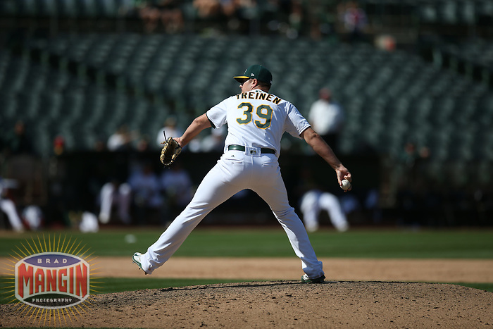 OAKLAND, CA - AUGUST 16:  Blake Treinen #39 of the Oakland Athletics pitches against the Kansas City Royals during the game at the Oakland Coliseum on Wednesday, August 16, 2017 in Oakland, California. (Photo by Brad Mangin)
