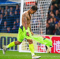 Roberto Firmino of Liverpool celebrates his goal during the EPL - Premier League match between Crystal Palace and Liverpool at Selhurst Park, London, England on 29 October 2016. Photo by Steve McCarthy.