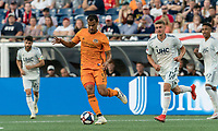 FOXBOROUGH, MA - JUNE 29: Juan Cabezas #5 passes the ball as Justin Rennicks #12 closes during a game between Houston Dynamo and New England Revolution at Gillette Stadium on June 29, 2019 in Foxborough, Massachusetts.