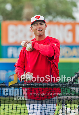 7 March 2015: Washington Nationals bullpen catcher Octavio Martinez tosses batting practice prior to a Spring Training game against the St. Louis Cardinals at Space Coast Stadium in Viera, Florida. The Nationals rallied to defeat the Cardinals 6-5 in Grapefruit League play. Mandatory Credit: Ed Wolfstein Photo *** RAW (NEF) Image File Available ***