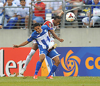 Andy Najar (14) of Honduras goes against Junior Diaz (15) of Costa Rica.  Honduras defeated Costa Rica 1-0 at the quaterfinal game of the Concacaf Gold Cup, M&T Stadium, Sunday July 21 , 2013.