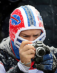 3 January 2010: A Buffalo Bills fan checks his camera during a game against the Indianapolis Colts on a cold, snowy, final game of the season at Ralph Wilson Stadium in Orchard Park, New York. The Bills defeated the Colts 30-7. Mandatory Credit: Ed Wolfstein Photo