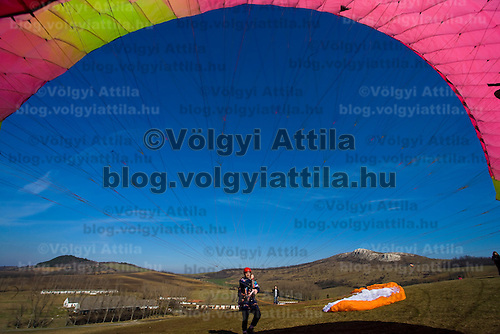 Paragliders practice on a hilltop some 25 km from Budapest.