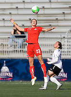 Kristi Eveland of the Washington Freedom heads the ball away from Lyndsey Patterson of the Philadelphia Independence during their preseason game at the Maryland SoccerPlex in Germantown, Maryland.