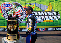 Sep 20, 2015; Concord, NC, USA; NHRA top fuel driver Antron Brown walks past the championship trophy prior to the Carolina Nationals at zMax Dragway. Mandatory Credit: Mark J. Rebilas-USA TODAY Sports