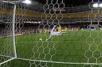 DC United forward Josh Wolff (16) scores his goal against Columbus Crew goalkeeper William Hesmer (11)   DC United defeated The Columbus Crew 3-1  at the home season opener, at RFK Stadium, Saturday March 19, 2011.