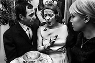 October 1966. Manhattan, NYC. Bette Davis congratulates Charles Aznavour after his performace at the Garry Moore Show at the CBS Studio 50. Ulla Thorsell on the right.