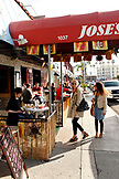USA, California, San Diego, two women stop to look inside Jose's Restaurant in La Jolla