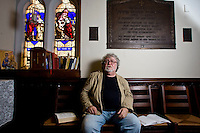 Waterbury, Conn. - July 21, 2009 - Rev. Jim Bradley of St. John's Episcopal Church on the Waterbury Green pauses while reading a prayer book at the church on Tuesday. Bradley, who has been at the church for 20 years, said that he has noticed not only a shift in his church over the past few decades, but in all churches. At the Episcopal Church's general convention last week in Anaheim, the church voted to allow for the consecration of bishops who are openly gay, and to create a liturgy to bless same-sex couples..Josalee Thrift Photo