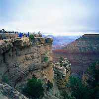 Grand Canyon National Park, Arizona, USA - Tourists standing at South Rim Viewpoint overlooking Colorado River