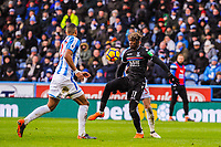 Crystal Palace's midfielder Wilfried Zaha (11) takes the ball down during the EPL - Premier League match between Huddersfield Town and Crystal Palace at the John Smith's Stadium, Huddersfield, England on 17 March 2018. Photo by Stephen Buckley / PRiME Media Images.