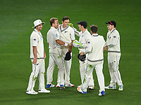 Trent Boult celebrates with team mates after taking a catch to dismiss Stoneman.<br /> New Zealand Blackcaps v England. 1st day/night test match. Eden Park, Auckland, New Zealand. Day 4, Sunday 25 March 2018. &copy; Copyright Photo: Andrew Cornaga / www.Photosport.nz
