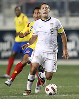 Clint Dempsey #8 of the USA MNT moves the ball away from John Javier Restrepo #21\ of Colombia during an international friendly match at PPL Park, on October 12 2010 in Chester, PA. The game ended in a 0-0 tie.
